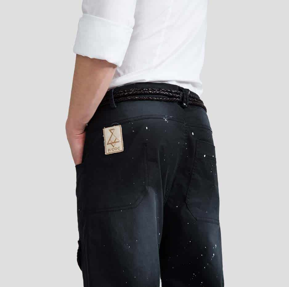 Black pants with pockets and paint splashes