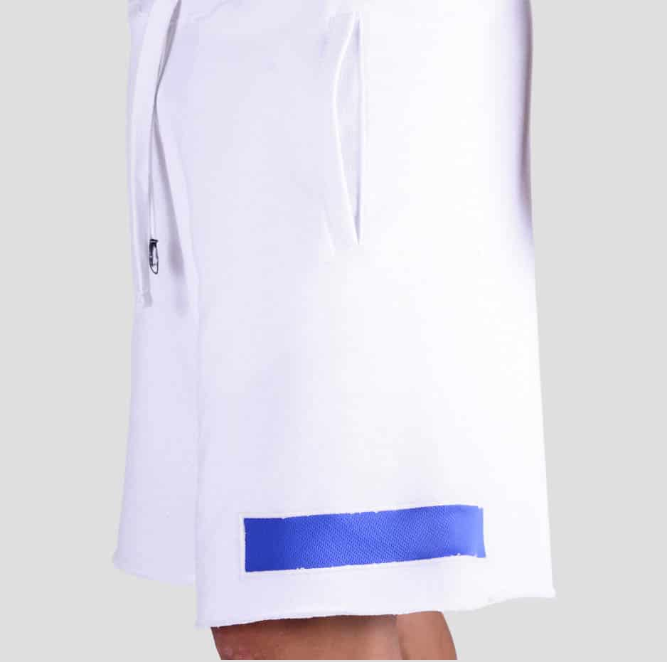 White shorts with a blue rectangular pattern sideways