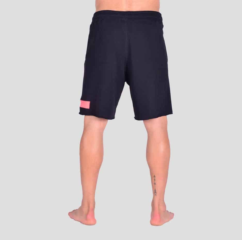 Black shorts with a coral rectangular pattern sideways