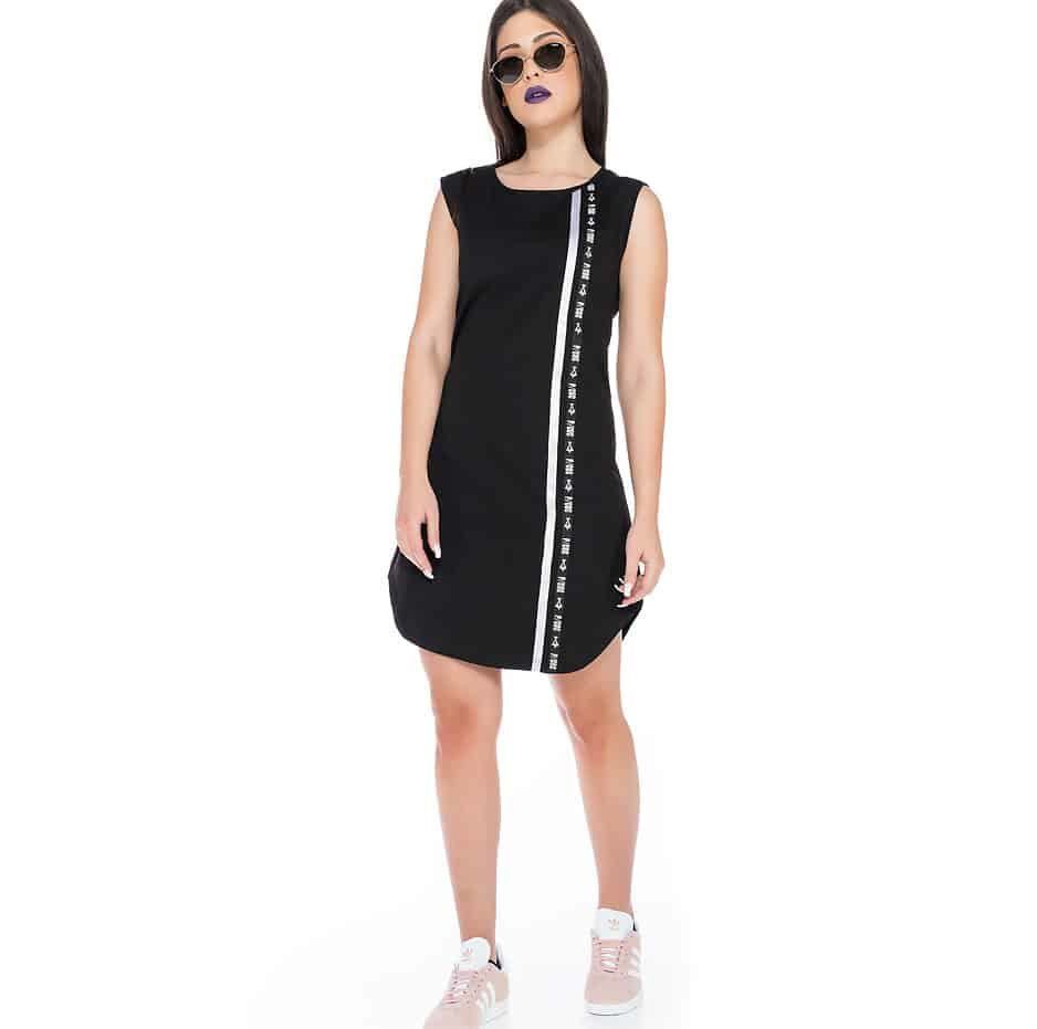 Sleeveless black dress with P/COC tape and a white lane