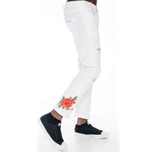 White slim fit pants with rose on hem