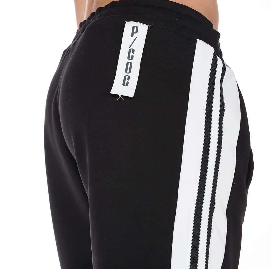 Black and white shorts with stripes on the side