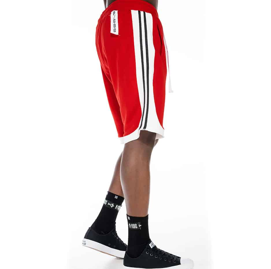 Red and white shorts with stripes on the side