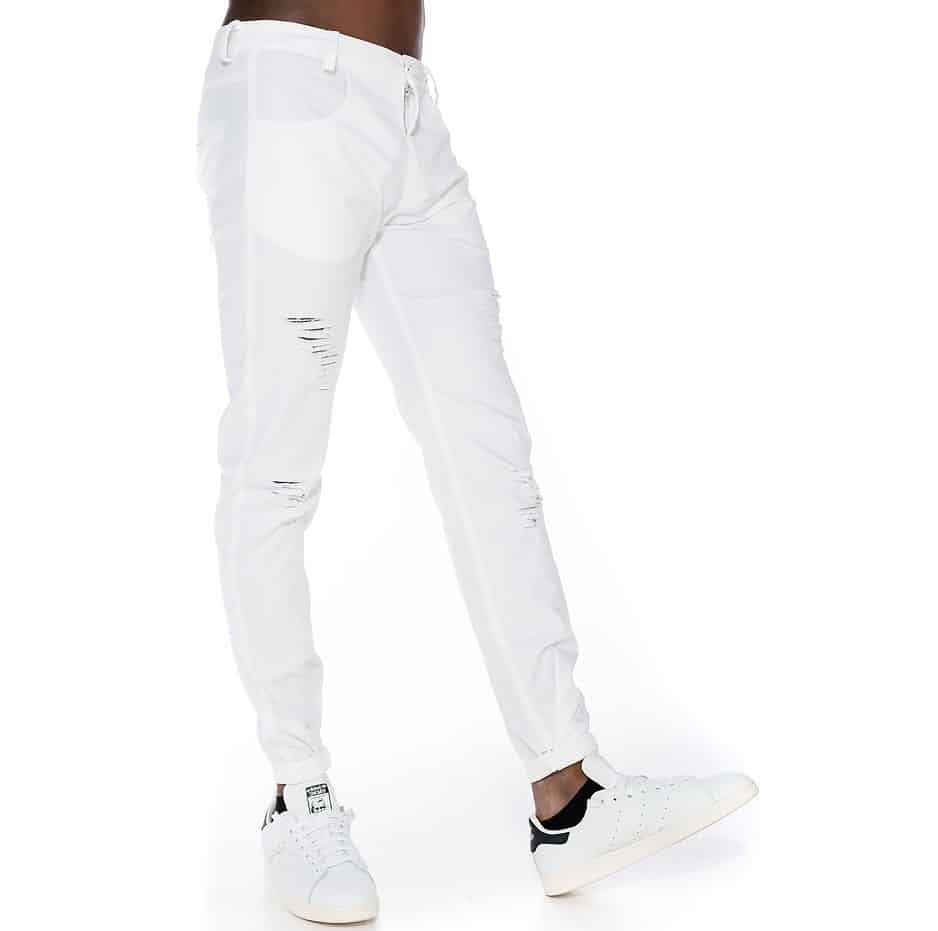 White pants with tearings and slim fit