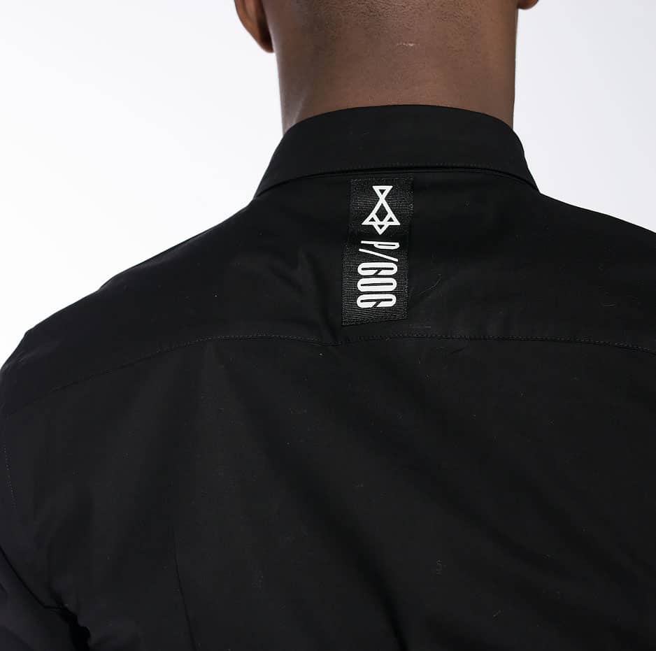 Black shirt with P/COC logo on the back