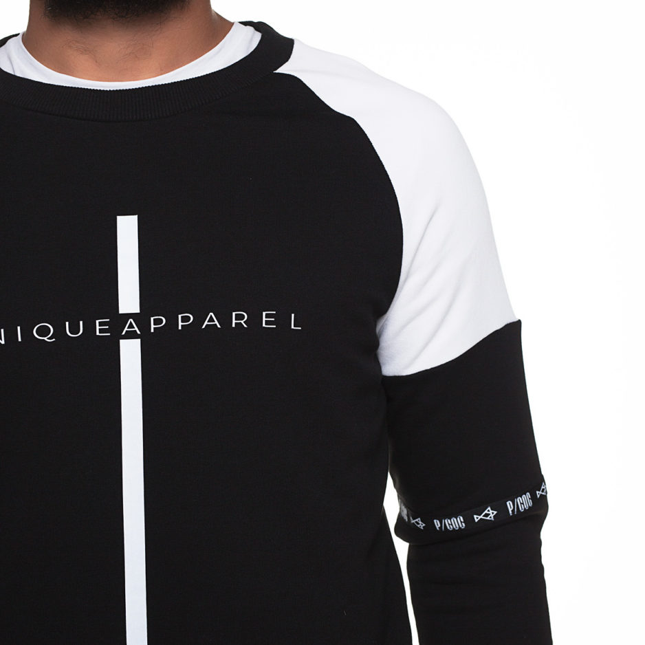 "Black and white sweater with ""Unique Apparel"" printing"