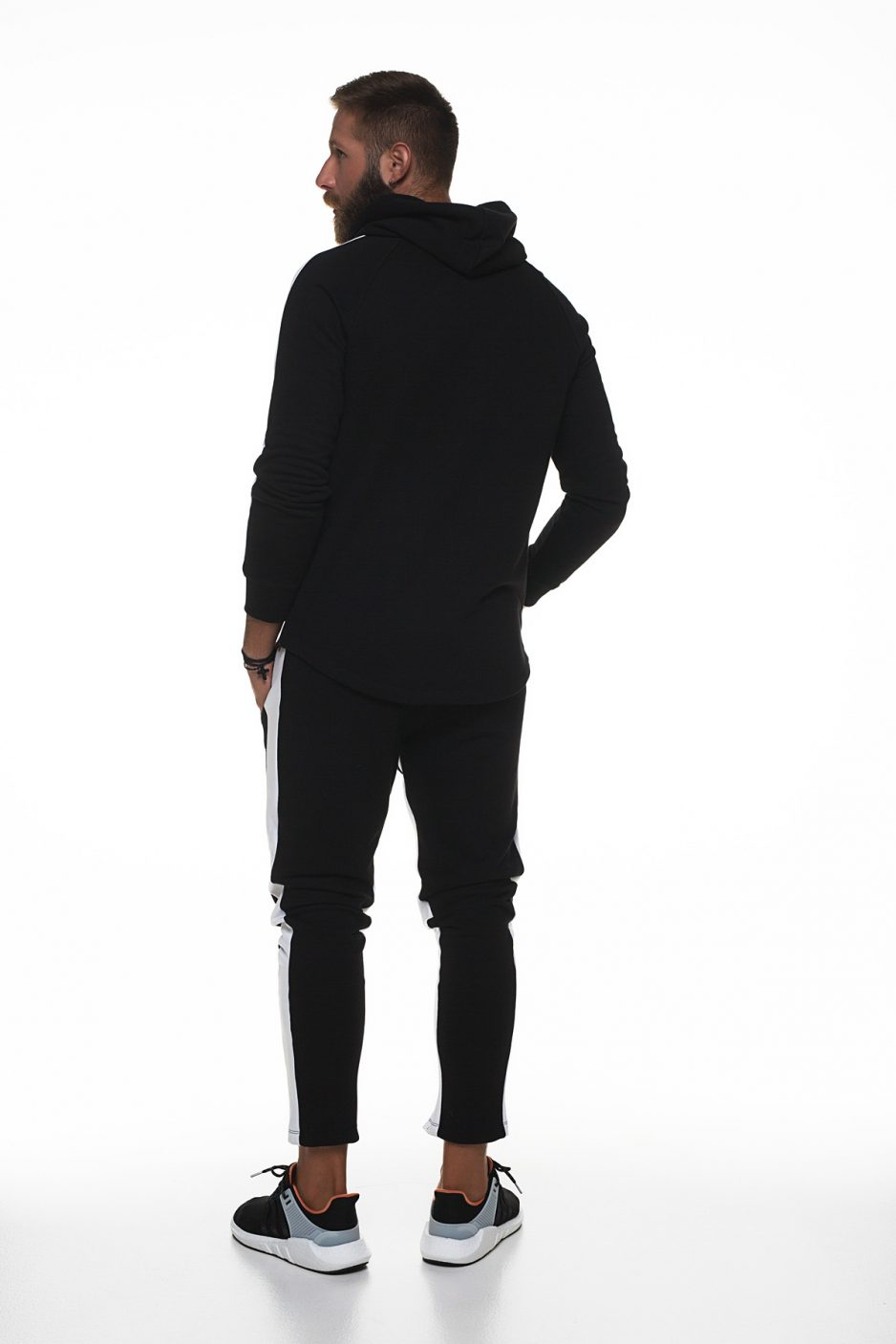 Black hoodies with white stripes on sleeves